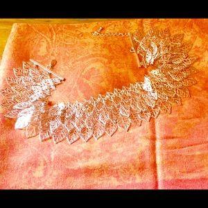 Gold leaf collar necklace.